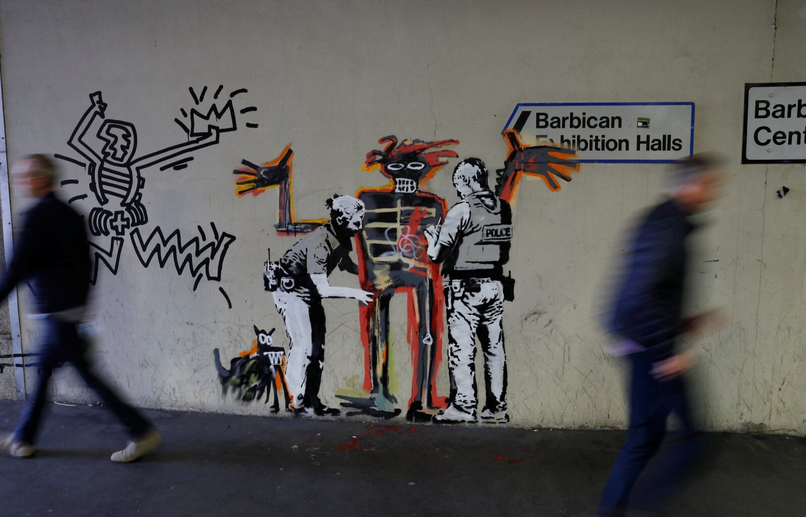 A mural painted by the artist Banksy, near the Barbican Center in London.